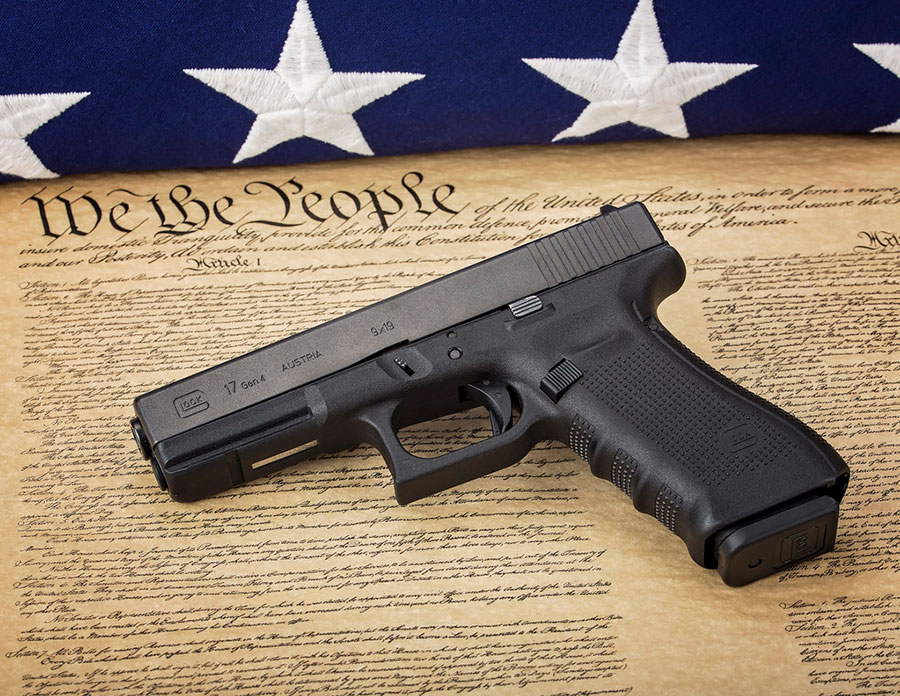 Pistol laying on the constitution image